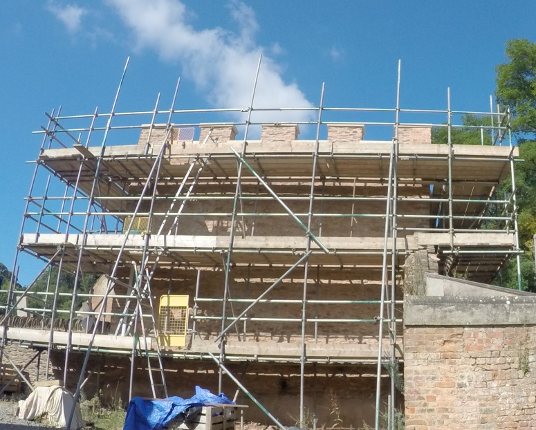 The battlements and east wall being renewed. (Courtesy of Architectural Thread)