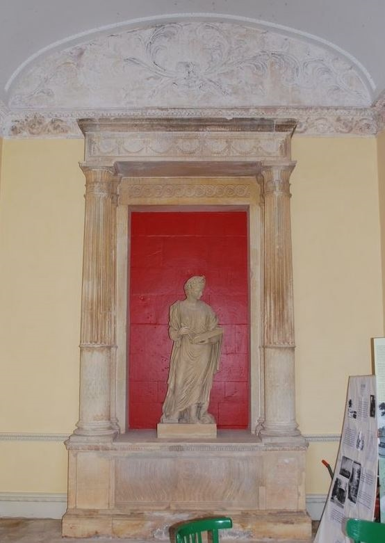 Robert Adam's design as built, abandoned and left ruinous, then saved by the Somerset Building Preservation Trust. The statue of Terpsichore is a replica of the original which left the estate in 1950 and was purchased by the Museum of Somerset, with aid from the Art Fund, in 1994.