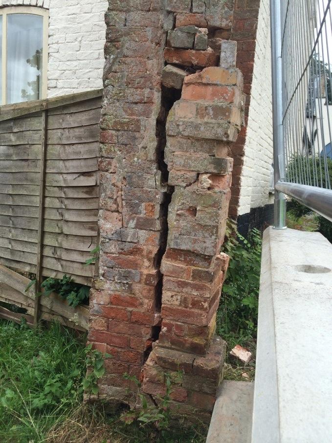 A dangerously crumbling gate pillar