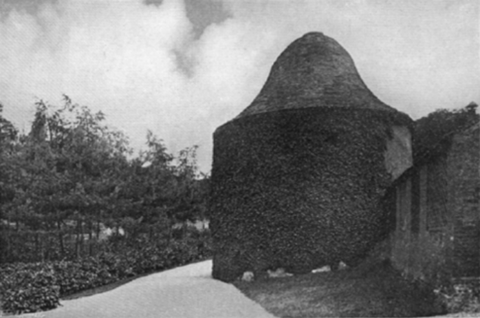 By at least 1908, when this photo was taken, the riding school had ceased to function and had been turned over to become part of the gardens. The C17th dovecote is the gardens most prominent feature with the C18th lean-to stable buildings to the far right.