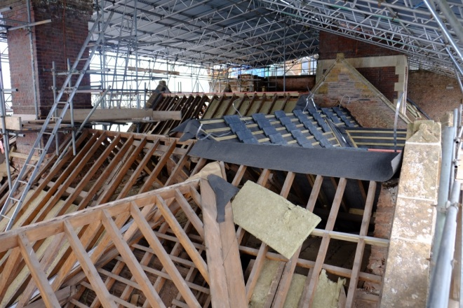 2. Insulation complete, the felt and batons are applied and the slates delivered. (Courtesy of Architectural Thread)