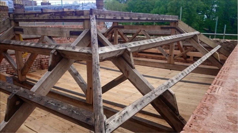 The roof void area designated for the new bat roost, assessable through openings in the slate and lead roof.