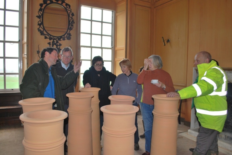 A few days before the chimney pots are put in place they act as useful tables in the Mansion House, with Edward Strachan, Stuart Senior, Claire Fear of Architectural Thread, Helen Senior, Camilla Carter of the Somerset Gardens Trust and Councillor Ian Dyer of Sedgemoor District Council.