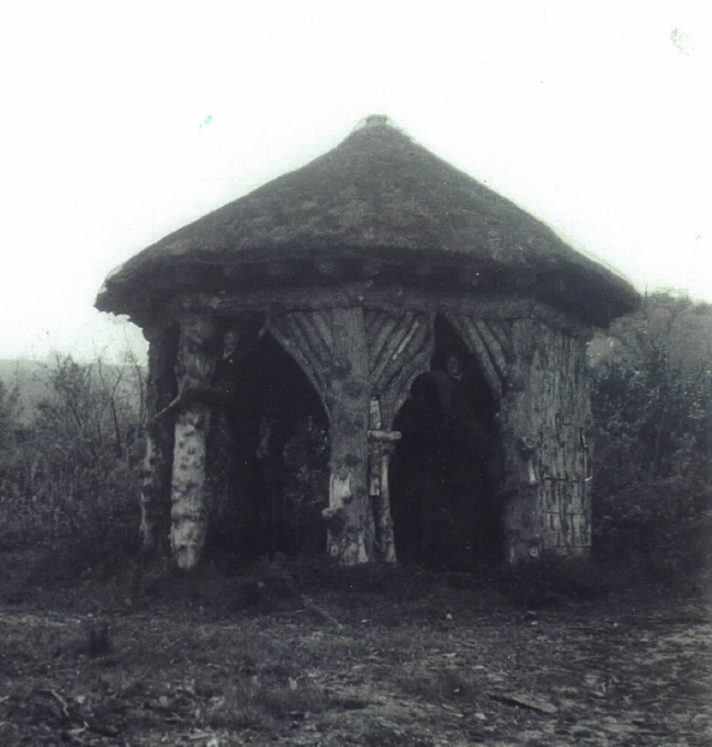 The Druid's Hut, 200 years after it was built, photographed in the 1960's with two children playing impishly in the arches – photograph courtesy of Mrs Gill Durman.