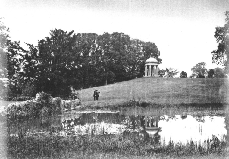The rusticated stone bridge on top of the Grotto, photographed from the north lawn in the 1890's. Water from the pond would appear to flow under this bridge on the left (obscured by foliage), but by 1771 this water cascade was removed and subterranean pipework fitted to take the overflow of water away invisibly and down to the ponds near the gate lodge.